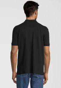 U.S. Polo Assn. - Polo shirt - black - 1
