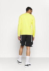 Puma - Long sleeved top - yellow - 2