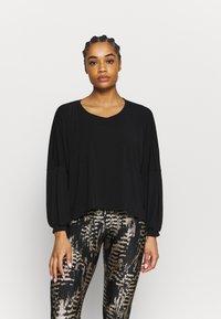 Onzie - Long sleeved top - black - 0