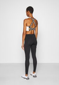 ONLY PLAY Tall - ONPPERFORMANCE - Leggings - Trousers - black/red - 2