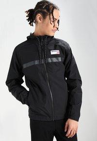 New Balance - ATHLETICS - Summer jacket - black - 0