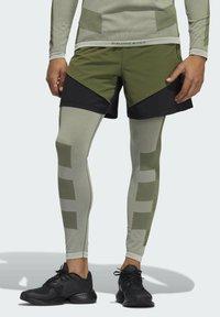 adidas Performance - STUDIO TECH SHORTS - Sports shorts - green - 0