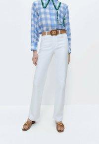 Uterqüe - Straight leg jeans - white - 0