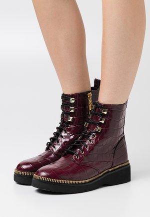 HASKELL BOOTIE - Platform ankle boots - dark berry