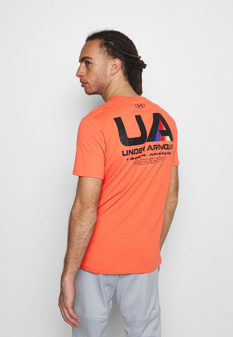 Under Armour - LOCKERTAG  - Camiseta estampada - red