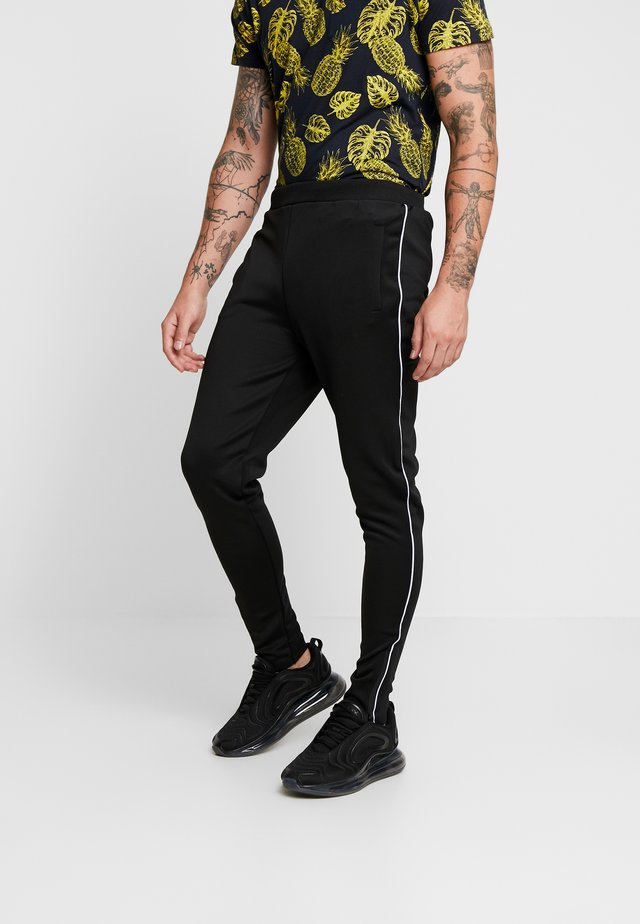 MAYALLB - Tracksuit bottoms - black/white