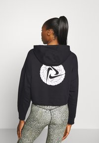 Nike Performance - W NK ICNCLSH DRY FLC PT TP GD - Hoodie - black/white