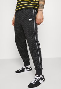 Nike Sportswear - REPEAT - Tracksuit bottoms - black/white - 3