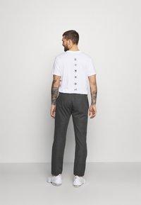 Champion - STRAIGHT HEM PANTS - Tracksuit bottoms - mottled dark grey - 2