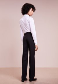 HUGO - HINASS - Trousers - black