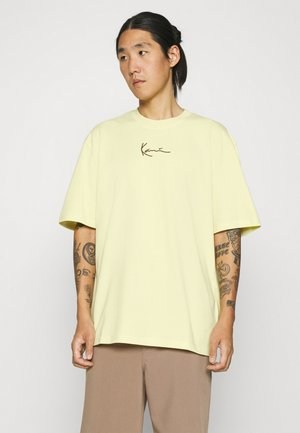 UNISEX SMALL SIGNATURE TEE  - T-shirts med print - light yellow