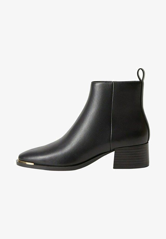 MINUTE - Korte laarzen - schwarz