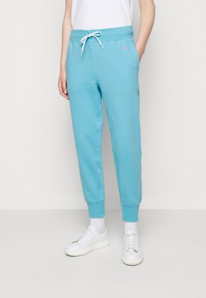 FEATHERWEIGHT - Tracksuit bottoms - perfect turquoise