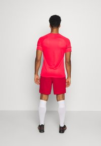 Nike Performance - SHORT - Sports shorts - university red/white - 2