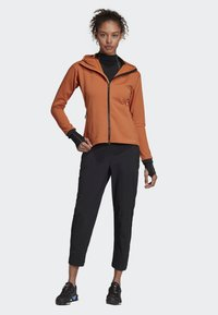 adidas Performance - TERREX CLIMAHEAT HOODED FLEECE - Fleece jacket - brown - 1