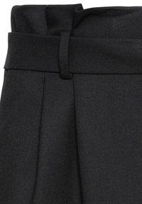 HALLHUBER - PAPERBAG-ROCK - Pencil skirt - black - 4