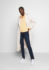 Marc O'Polo - TROUSER - Slim fit jeans - dark blue base wash - 1