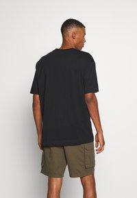 Good For Nothing - OVERSIZED SCRIPT - T-shirt print - black - 2