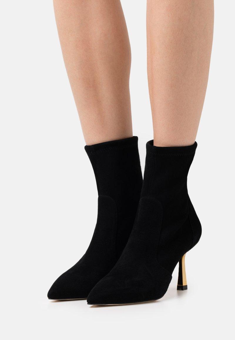Stuart Weitzman - MAX BOOTIE - Classic ankle boots - black/gold
