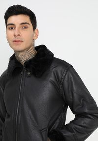 Alpha Industries - Faux leather jacket - black - 4