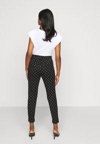 ONLY Petite - ONLPOPTRASH EASY DOT PANT - Trousers - black - 2