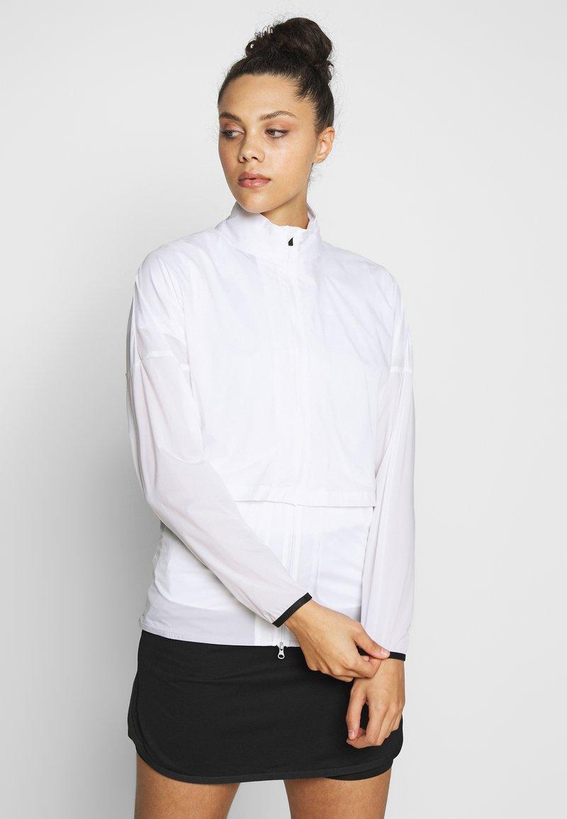 Nike Golf - REPEL ACE JACKET FULL ZIP 2-IN-1 - Sportovní bunda - white/black