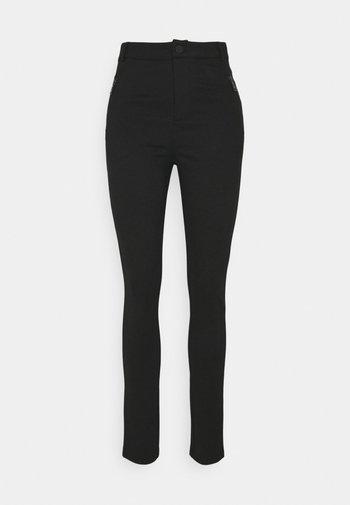 PUNTA TREGGING - Trousers - black