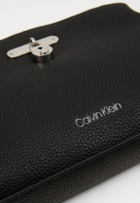 Calvin Klein - DRESSED BUSINESS CROSSBODY - Sac bandoulière - black - 5