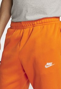 Nike Sportswear - CLUB - Tracksuit bottoms - magma orange/white - 3