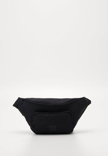 KALORI CROSSBODY BAG - Bum bag - black