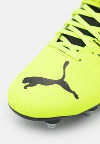 Puma - FUTURE Z 4.1 MXSG - Screw-in stud football boots - yellow alert/black/white - 5
