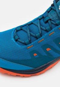 Columbia - VAPOR VENT - Hiking shoes - pool/red quartz - 5