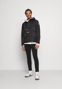 The North Face - STEEP TECH LIGHT RAIN JACKET - Waterproof jacket - black - 1