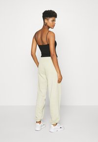 BDG Urban Outfitters - Tracksuit bottoms - sand - 2