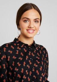 Monki - NADINA BLOUSE - Button-down blouse - black dark - 3