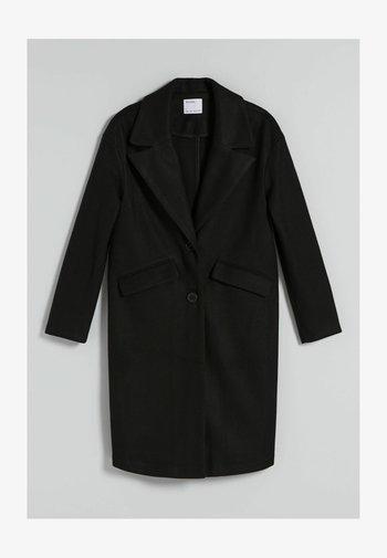MIT FALLENDEN SCHULTERNÄHTEN  - Classic coat - black