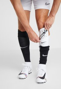 Nike Performance - MERCURIAL LITE - Espinilleras - white/black - 0
