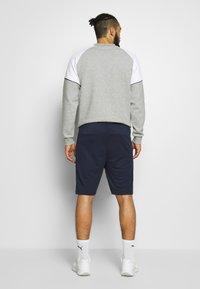 Hummel - HMLXANDER SHORTS - Sports shorts - black iris - 2