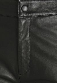 Object Petite - OBJVIOLA L CULOTTE - Leather trousers - black - 2