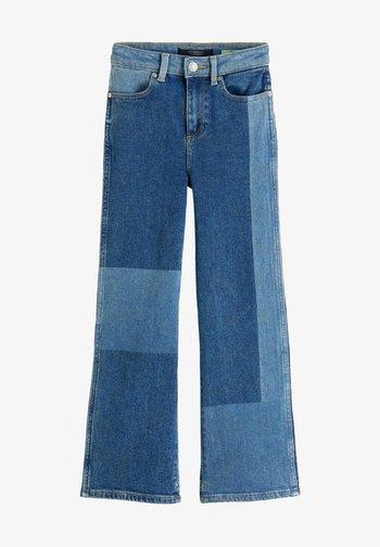 Flared Jeans - mottled blue
