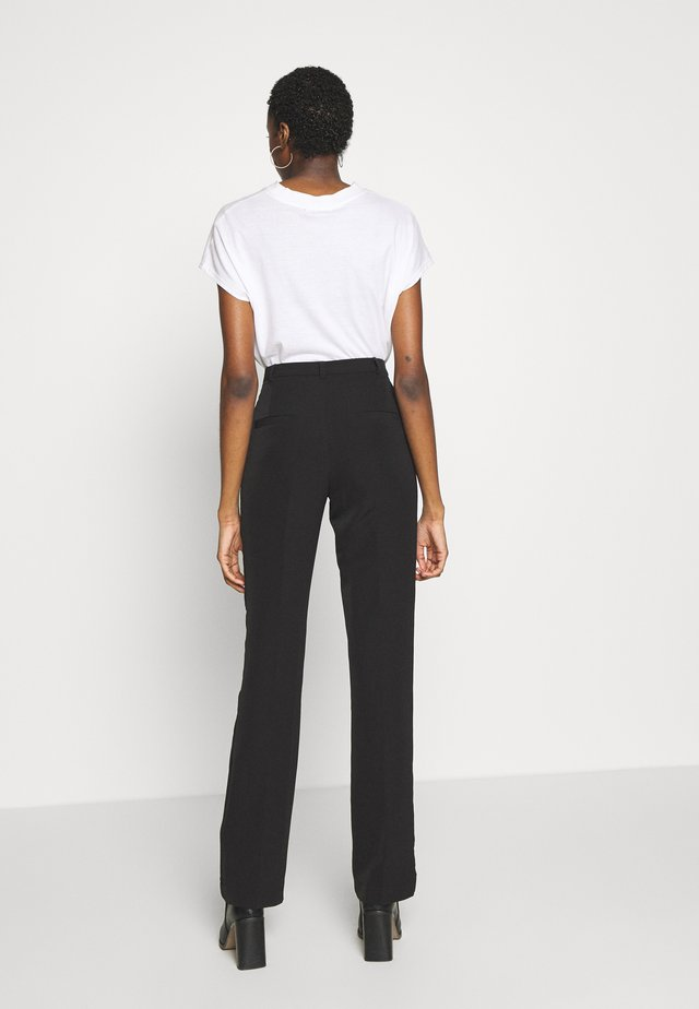 NANNA PANTS - Trousers - black