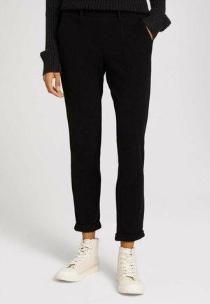 MIT ELASTISCHEM BUND - Trousers - deep black