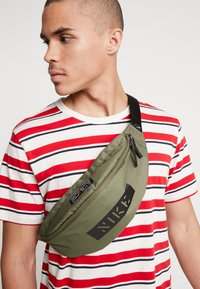 Nike Sportswear - HERITAGE HIP PACK - Bum bag - medium olive/white - 1