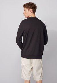 BOSS - WALKUP - Sweatshirt - black - 2