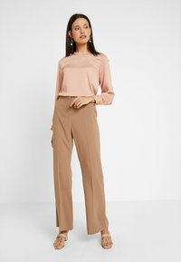 Dorothy Perkins - BOOTCUT - Trousers - light brown - 1