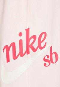 Nike SB - SUNDAY UNISEX - Tracksuit bottoms - orange pearl/coconut milk - 5
