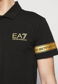 EA7 Emporio Armani - Polo shirt - black gold - 4