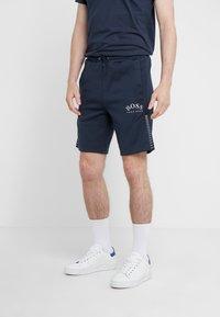 BOSS - HEADLO WIN - Pantalon de survêtement - blue/silver - 0