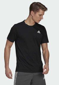 adidas Performance - AEROREADY DESIGNED 2 MOVE SPORT T-SHIRT - T-shirts med print - black - 2