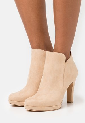 High heeled ankle boots - almond